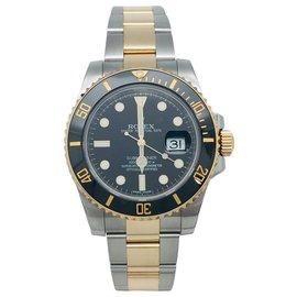 Rolex-Montre Rolex Submariner, or jaune et acier.-Autre