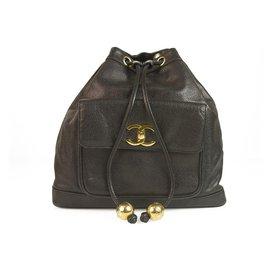 Chanel-Chanel CC Black Caviar Leather Large Vintage Drawstring Backpack front pocket-Black