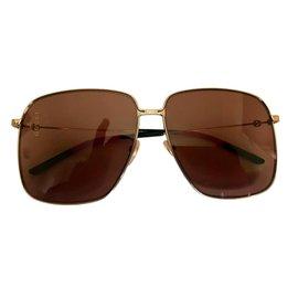 Gucci-Des lunettes de soleil-Autre