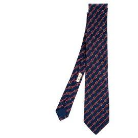 Hermès-Cravate Hermès en soie imprimée sur fond bleu marine en très bon état !-Bleu Marine