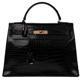 Hermès-Superbe Hermès Kelly 32 sellier en Crocodile Porosus noir, bijouterie plaquée or, en très bon état général !-Noir