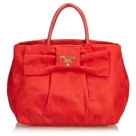 Prada-Sac à main Prada en nylon rouge avec nœud-Rouge
