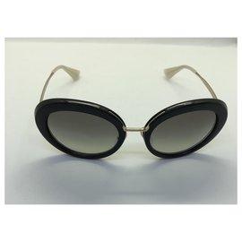 Prada-Des lunettes de soleil-Noir