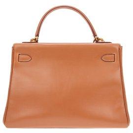 Hermès-Superbe Sac à main Hermès Kelly 32 bandoulière en cuir Gulliver couleur cognac avec sa pochette assortie en bon état !-Cognac