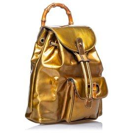 Gucci-Gucci Sac à dos à cordon en cuir de bambou doré-Doré