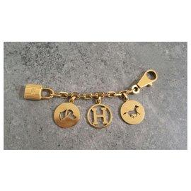 Hermès-Bijou de sac Hermes Gold Breloque-Doré
