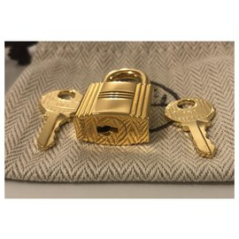 Hermès-Golden Hermes padlock for Birkin or kelly bags, new condition with 2 keys and original pouch!-Golden