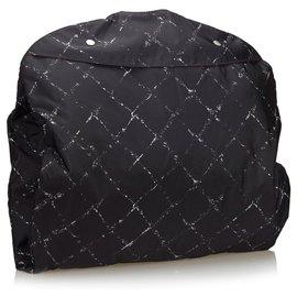 Chanel-Sac à vêtements Chanel noir Old Travel Line en nylon-Noir,Blanc