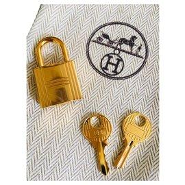 Hermès-Cadenas Hermès doré pour sacs Birkin ou kelly, Neuf 2 clés et pochon !-Doré