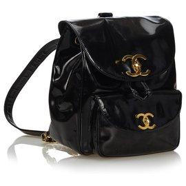 Chanel-Sac à dos à cordon en cuir verni noir Chanel-Noir