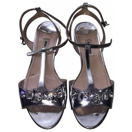 Miu Miu-Flat sandals in silver leather with rhinestones-Silvery