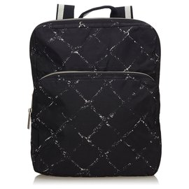Chanel-Sac à dos Chanel Noir Old Travel Line en nylon-Noir,Blanc