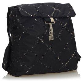 Chanel-Sac à dos Chanel en nylon noir vieux voyages-Noir,Blanc,Écru