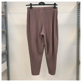Issey Miyake-Homme Plissé trousers-Pink