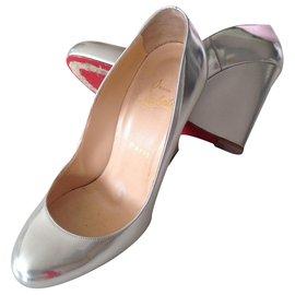Christian Louboutin-Wedge Heel Pump.-Silvery