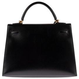 Hermès-Superbe et rare joyau: Hermès Kelly sellier 32 cm à bandoulière en cuir box noir et accastillage plaqué or en excellente condition !-Noir