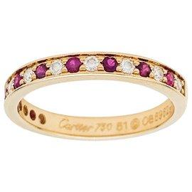 Cartier-Alliance Cartier en or jaune, rubis et diamants.-Autre