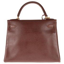 Hermès-Superbe Hermès Kelly 28 retourné à bandoulière en cuir Courchevel Cacao, accastillage plaqué or-Marron