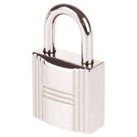 Hermès-Cadenas Hermès Palladié argenté pour sacs Birkin ou kelly, état neuf avec 2 clés et pochon d'origine!-Argenté