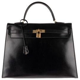 Hermès-Hermès Kelly 35 sellier en cuir box noir, accastillage plaqué or en bon état + !-Noir