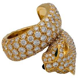 """Cartier-Bague Cartier """"Panthère de Cartier"""" en or jaune, diamants, émeraudes et onyx.-Autre"""