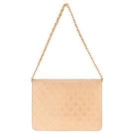 Chanel-Très beau Sac Chanel Classique vintage en cuir d'agneau matelassé beige, bijouterie dorée.-Beige