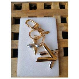 Louis Vuitton-Merveilleux bijoux de sac Louis Vuitton Twist-Argenté,Doré