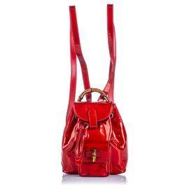 Gucci-Sac à dos à cordon en cuir verni de bambou rouge Gucci-Rouge