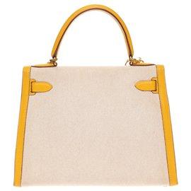 Hermès-hermes kelly 28 saddle bag shoulder strap bi-material canvas and leather courchevel yellow, garniture en métal doré-Beige