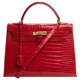 Hermès-Hermès Kelly 32 bandoulière en cuir Crocodile Porosus rouge braise, garniture en métal doré, en excellent état-Rouge
