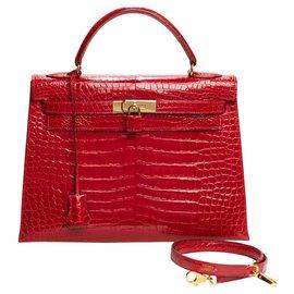 Hermès-Hermes Kelly 32 Lederschulterriemen Crocodile Porosus rote Glut, garniture en métal doré, In sehr gutem Zustand-Rot
