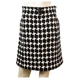 Chanel-Mélange de laine noir et blanc Chanel 07Une jupe longueur au genou de collection 36-Noir,Blanc