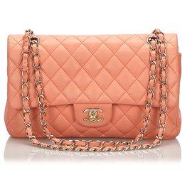 Chanel-Sac à rabat doublé orange moyen classique en peau d'agneau Chanel-Orange