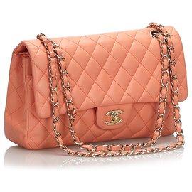 Chanel-Chanel Orange Classic Medium Flap Bag mit Lammfellfutter-Orange