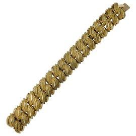 inconnue-Bracelet en or jaune, motifs de feuilles.-Autre