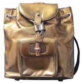 Gucci-gucci sac a  dos-Doré