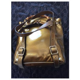 Gucci-gucci backpack-Golden
