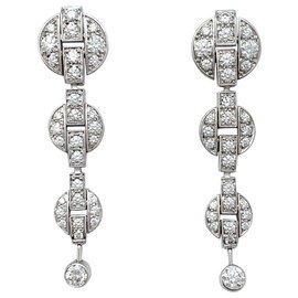 """Cartier-Boucles d'oreilles pendantes Cartier modèle """"Himalia"""" en or blanc, diamants.-Autre"""