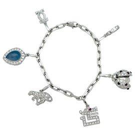 inconnue-Bracelet Cartier en or blanc, 6 breloques, calcédoine, diamants, émeraudes et rubis.-Autre