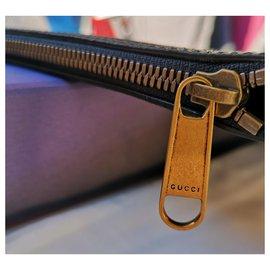 Gucci-Pochette modèle Imprimé cuir ners-Noir