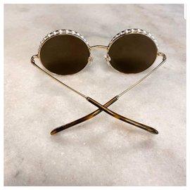 Chanel-Des lunettes de soleil-Noisette