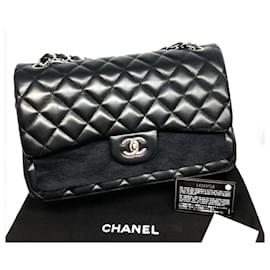 Chanel-Bolsa Chanel em pele de cordeiro preta Jumbo clássica-Preto