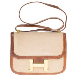 Hermès-Lovely vintage Hermès Constance shoulder bag in beige canvas and honey-colored epsom leather-Beige,Light brown