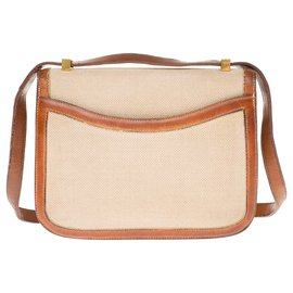 Hermès-Ravissant sac bandoulière Hermès Constance vintage en toile beige et cuir epsom couleur miel-Beige,Marron clair