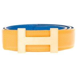 Hermès-Très belle ceinture Hermès Constance réversible en veau epsom jaune et bleu et boucle Quizz doré brossé-Bleu,Jaune