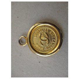 Chanel-Cambon medallion.-Golden