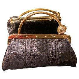 Gucci-Pochette Gucci en cuir de alligator-Noir