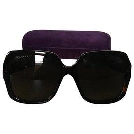Gucci-Des lunettes de soleil-Marron foncé
