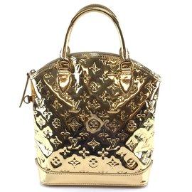 Louis Vuitton-Louis Vuitton Lockit Vertical PM Ouro Pvc-Dourado