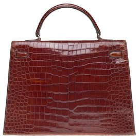Hermès-Splendide Hermès Kelly 35 en Crocodile Porosus marron, garniture en métal plaqué or-Marron